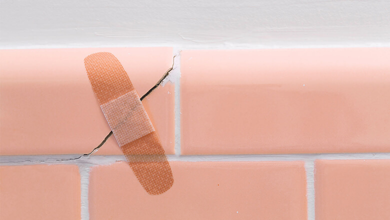 This image has an empty alt attribute; its file name is homerepair-bandaid-crackedtile_PL18165_81861_st_780x440.jpg
